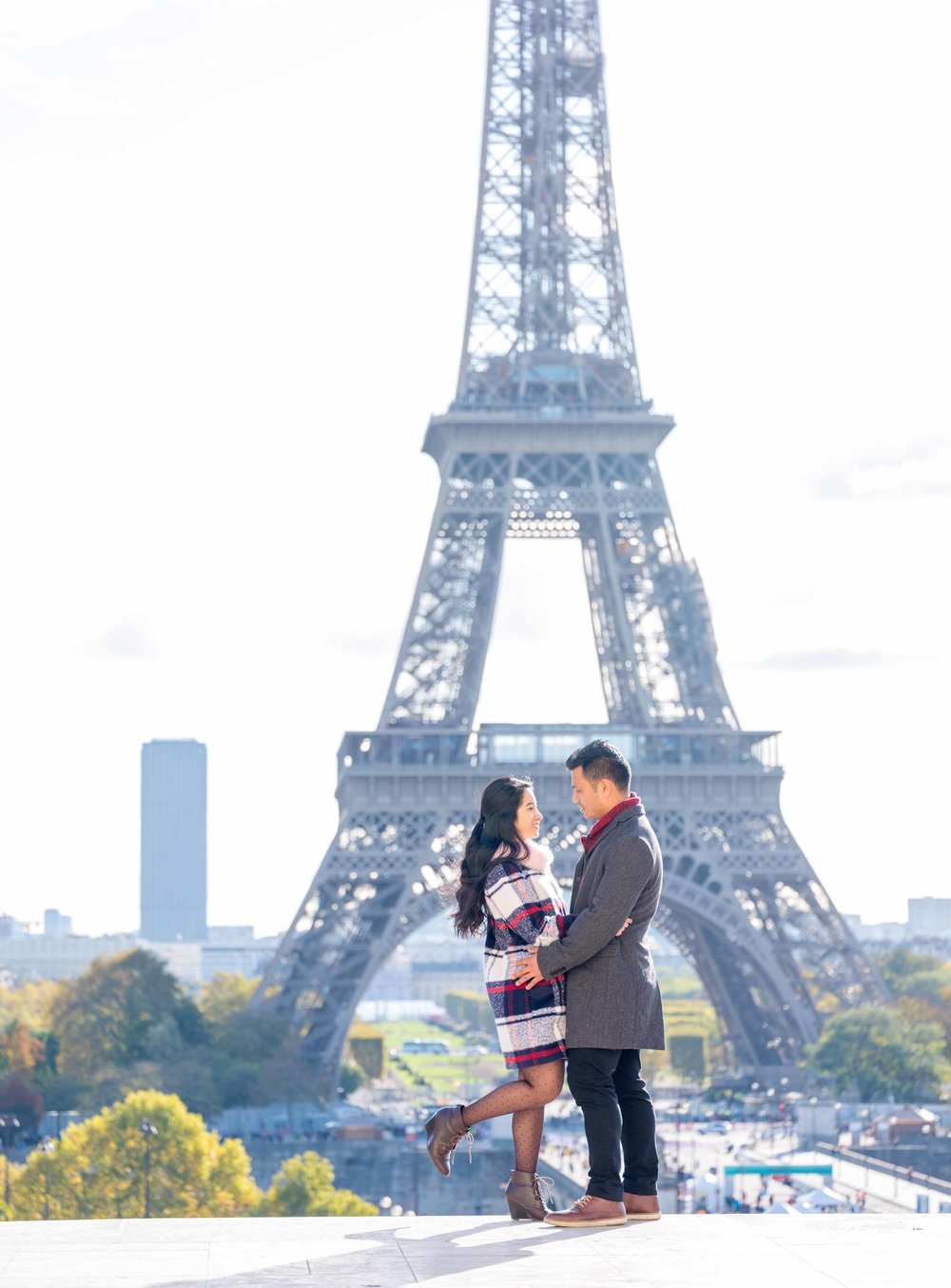 engaged couple at eiffel tower in paris