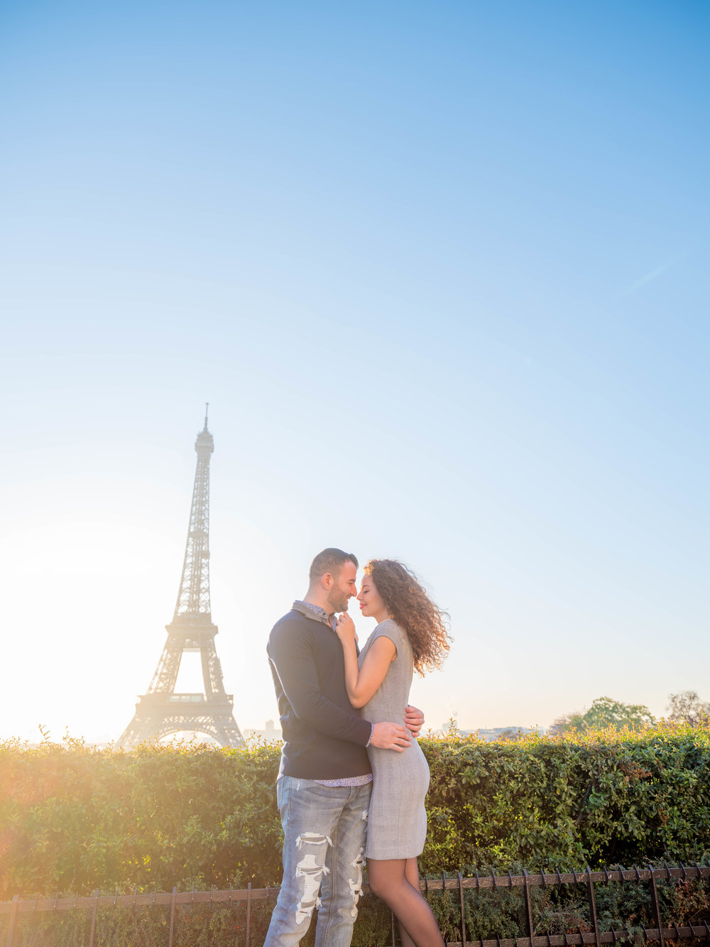 engaged couple at eiffel tower paris france