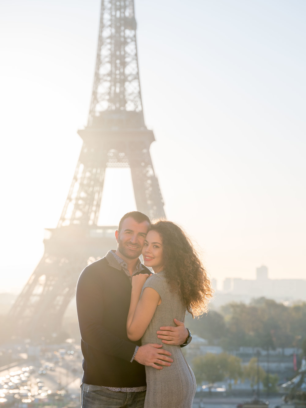 romantic couple posing at eiffel tower paris