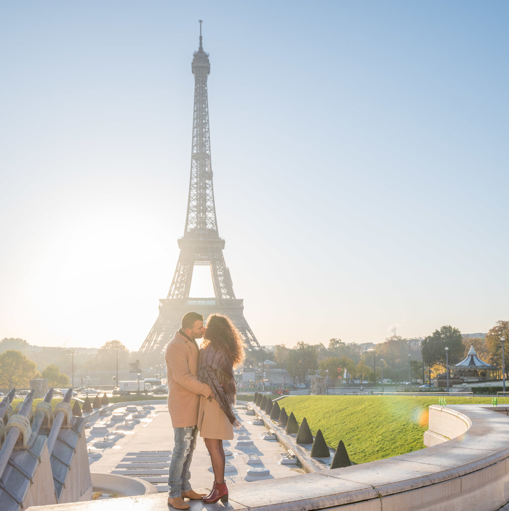 romantic couple kissing at eiffel tower in paris