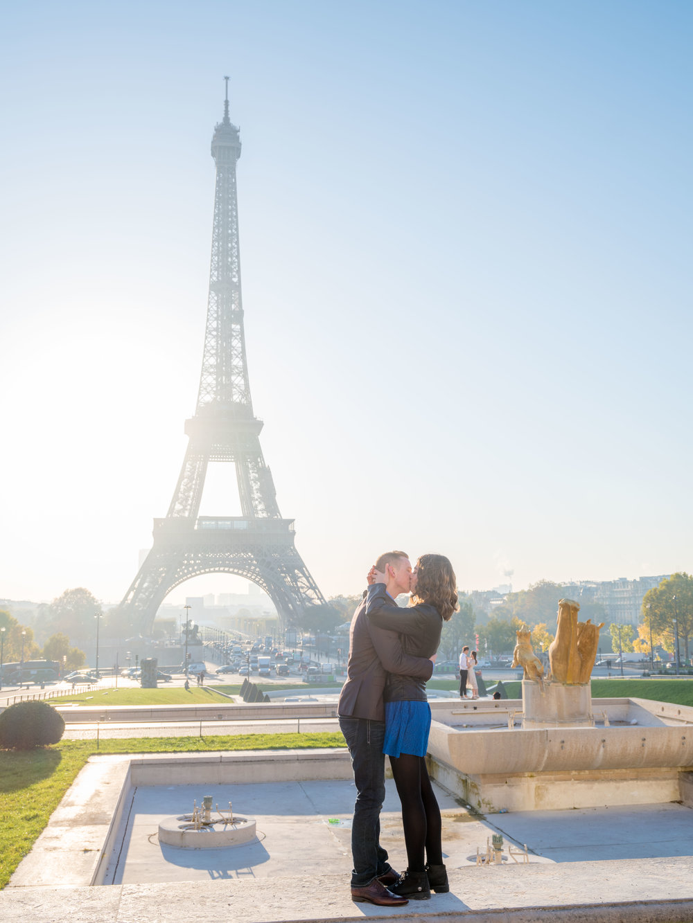 couple embracing surprise proposal paris eiffel tower