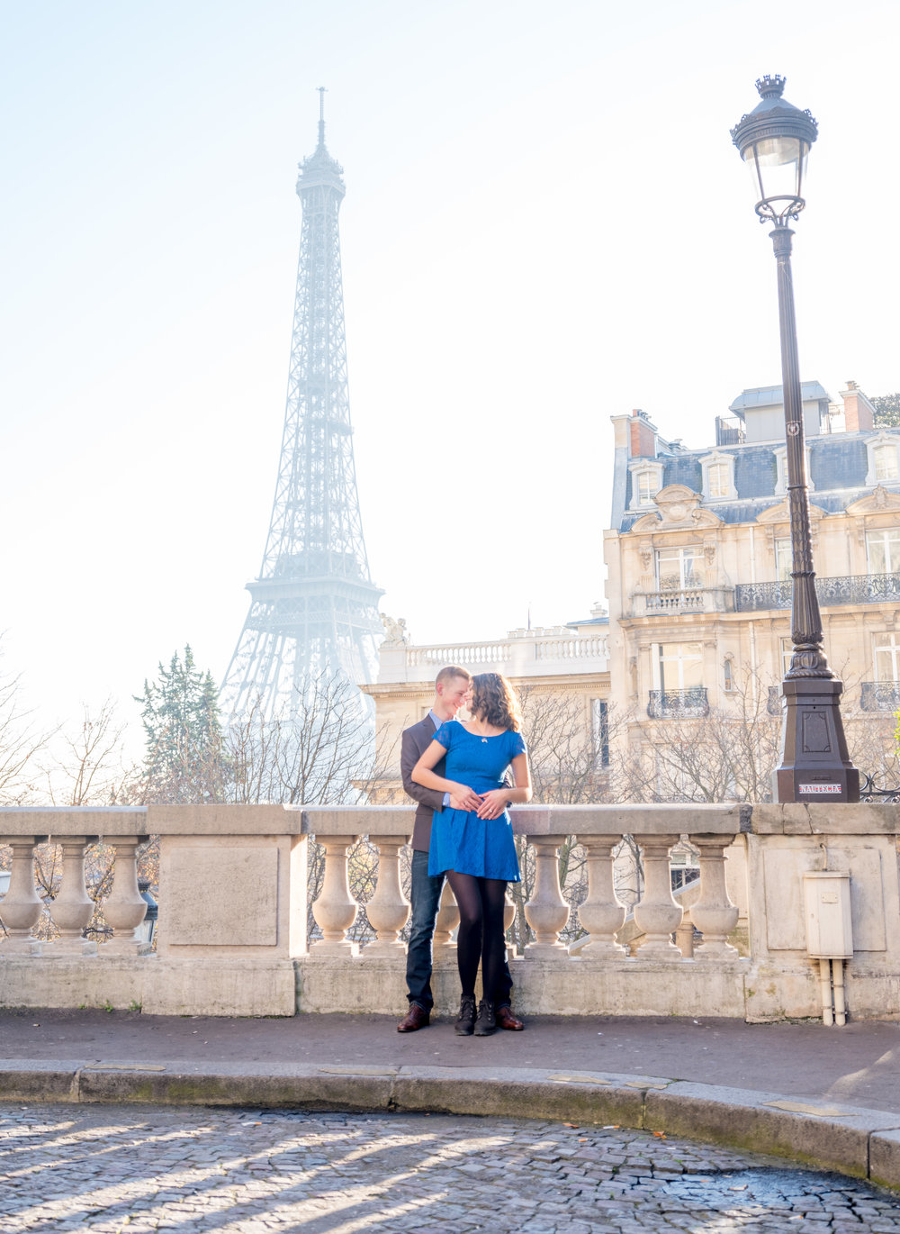 romantic couple with view of eiffel tower