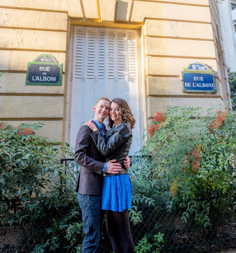 cute engaged couple posing in paris