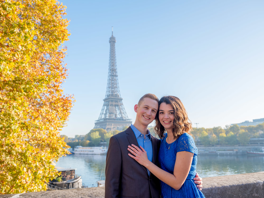 young engaged couple at eiffel tower in paris