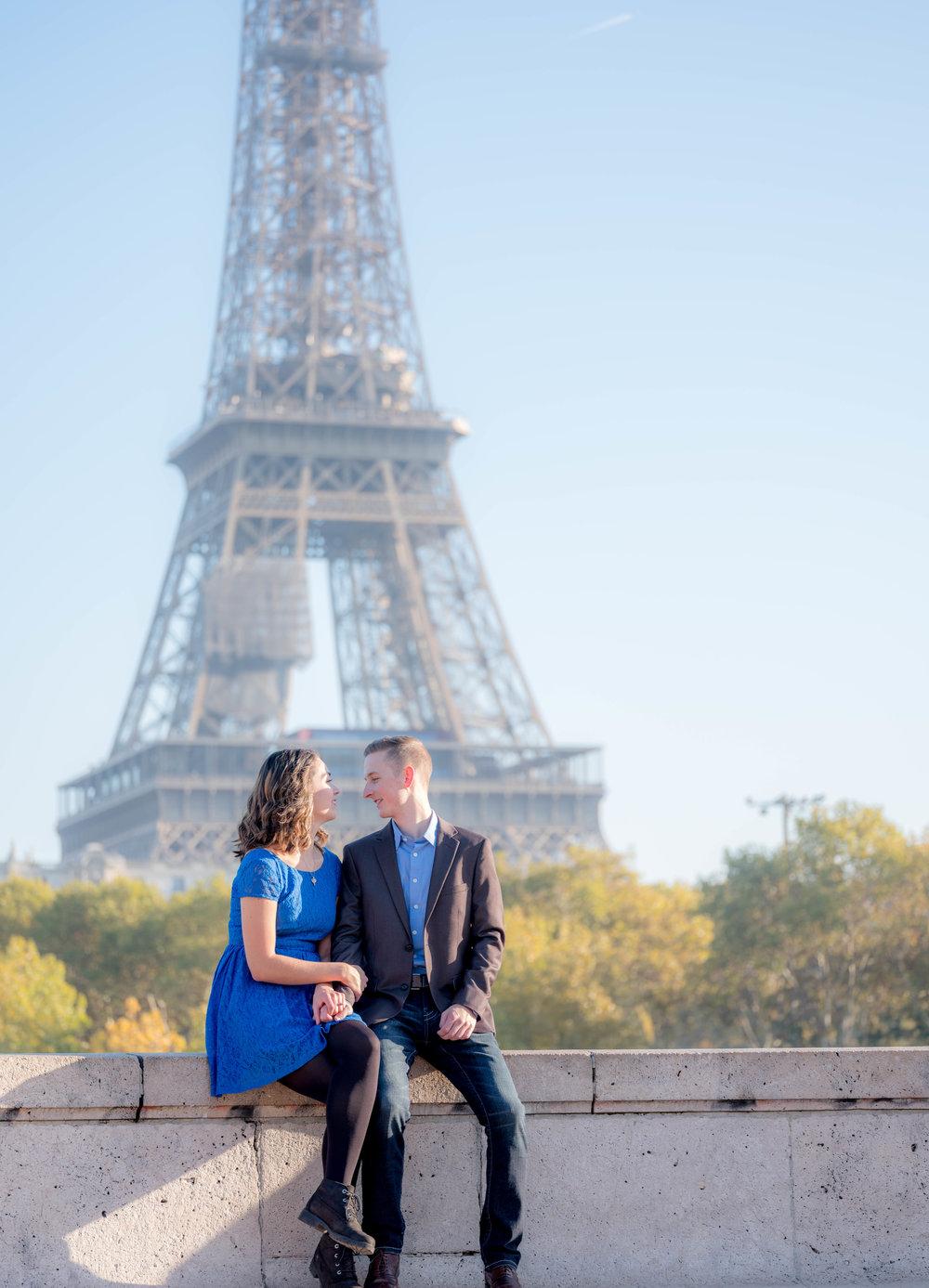 surprise proposal paris eiffel tower young couple