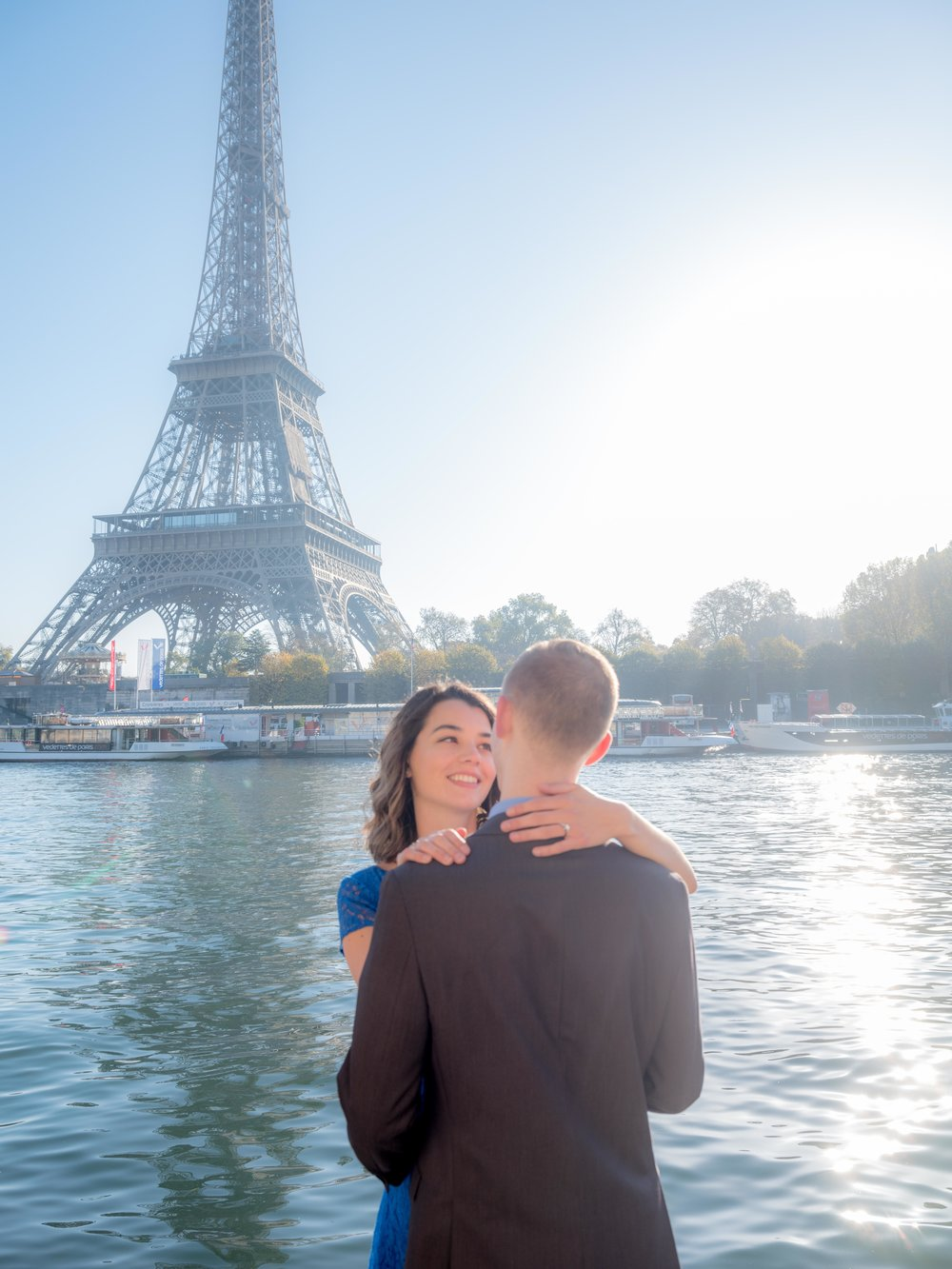 romantic young couple engagement in paris with view of eiffel tower