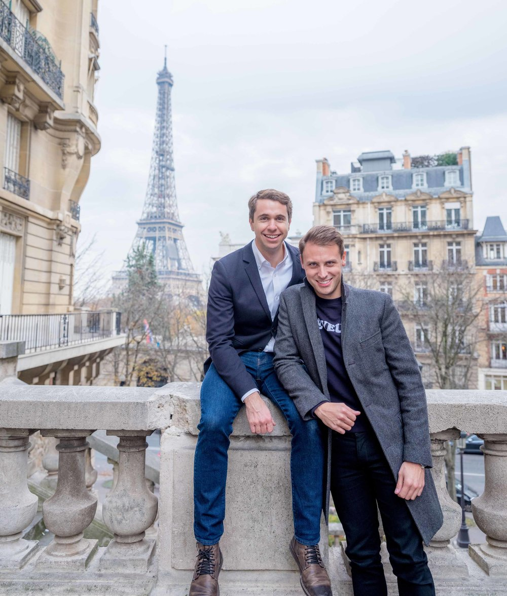 gay couple engaged at eiffel tower paris