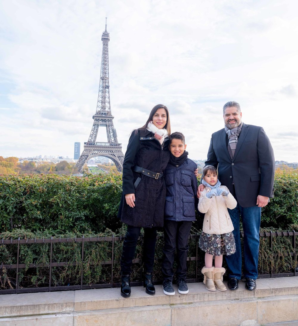 family at eiffel tower in paris france