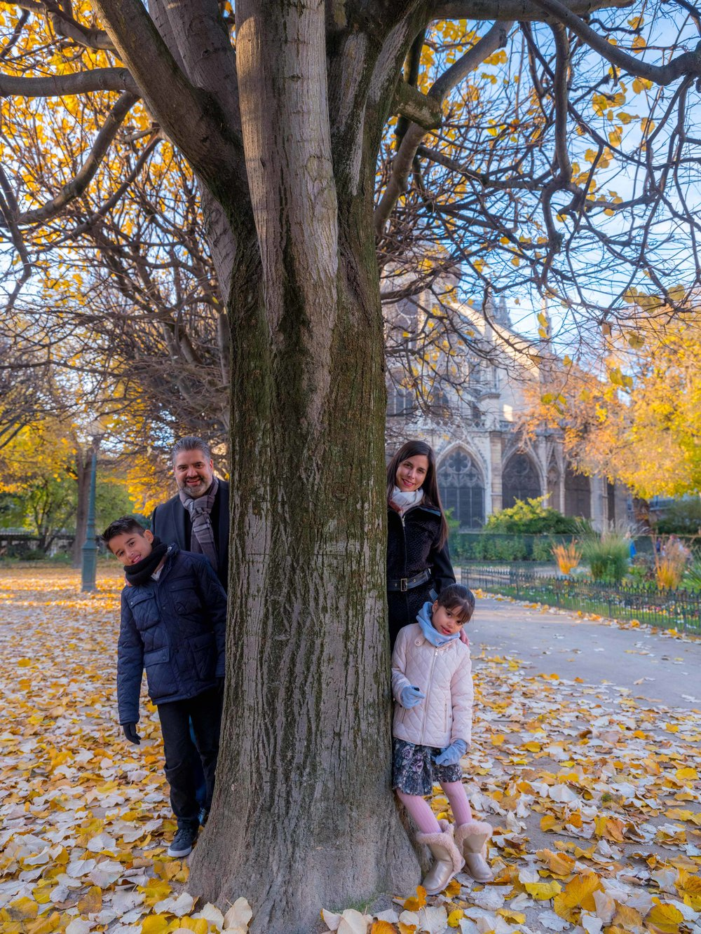 family in pqris in autumn at notre dame