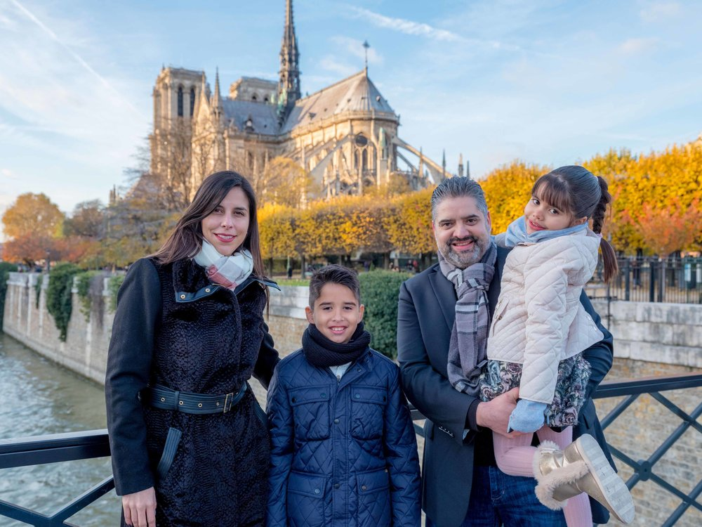 family in pqris in autumn at notre dame cathedral