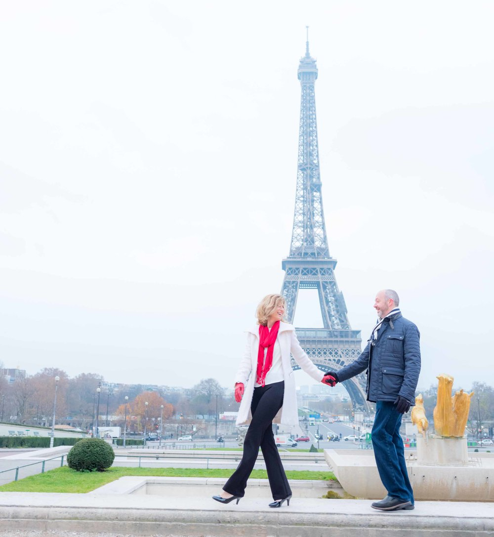 older couple in love at eiffel tower paris