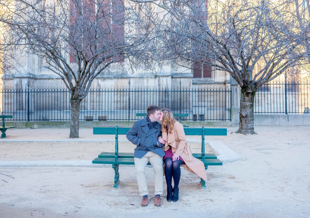 newly engaged couple in paris at notre dame