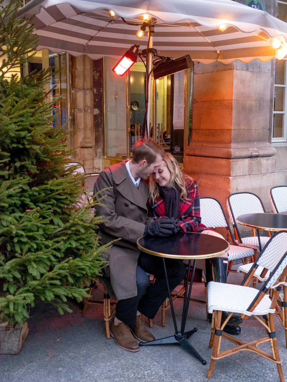 couple enjoying coffee at cafe paris france