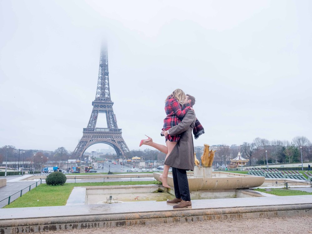couple in love at eiffel tower paris france