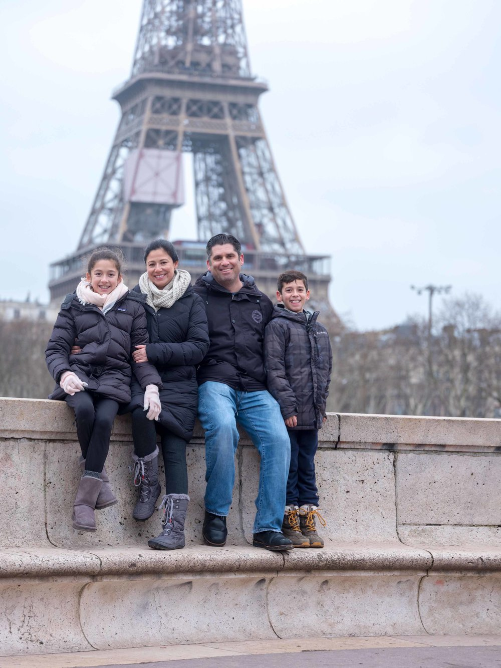 charming family photo session at eiffel tower in paris france