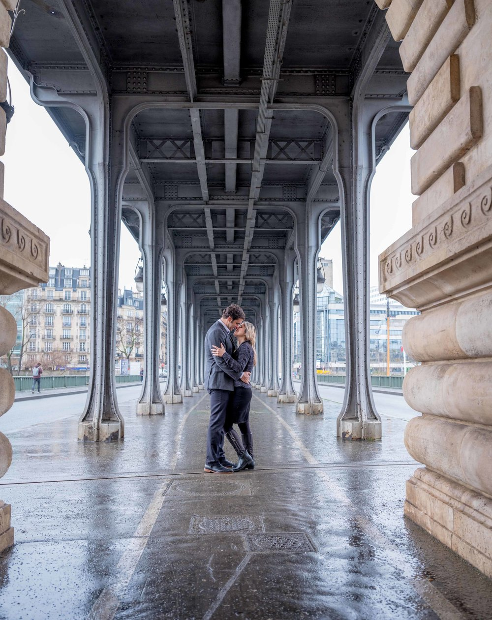 happy engaged couple at Eiffel Tower in Paris France