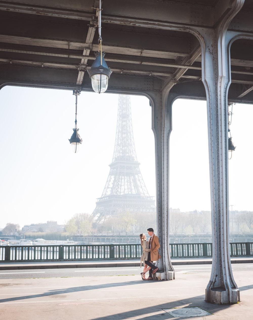 paris surprise proposal bir hakeim bridge overlooking eiffel tower in paris