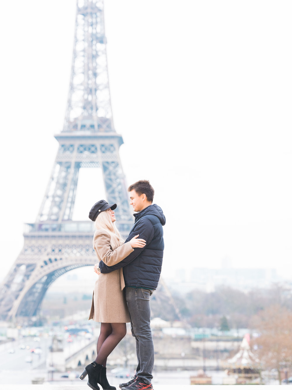 young couple in love at the eiffel tower in paris france