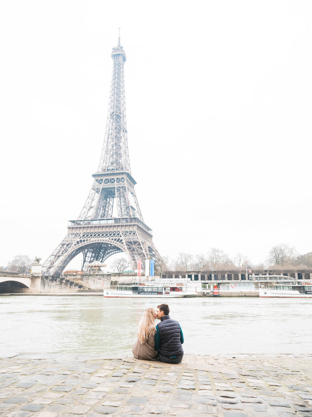 romantic engagement photo session at the eiffel tower in paris france on a winter's day