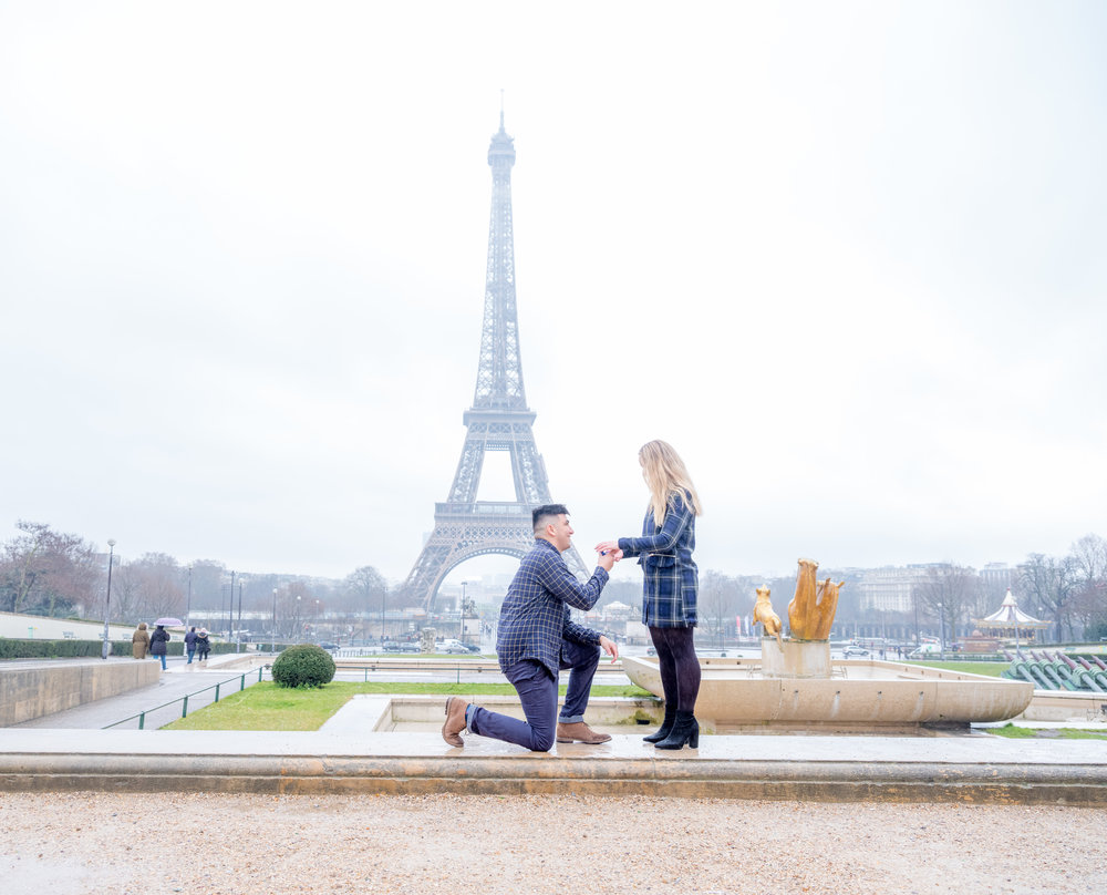 romantic surprise proposal at the eiffel tower in paris france