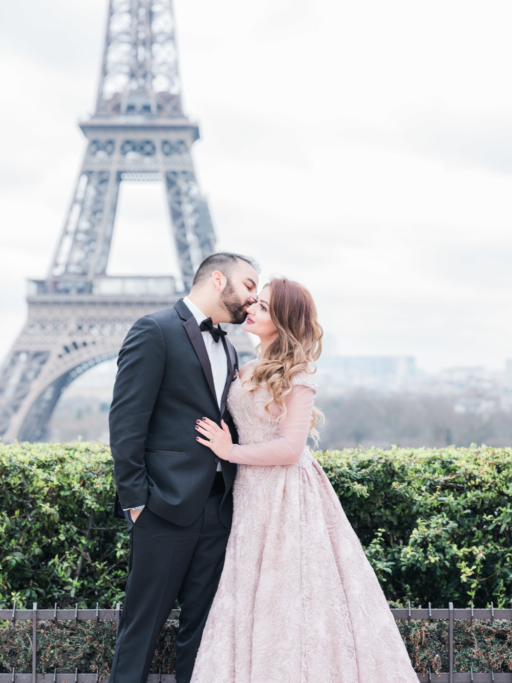 romantic couples photo shoot at eiffel tower in paris france in tux and gown