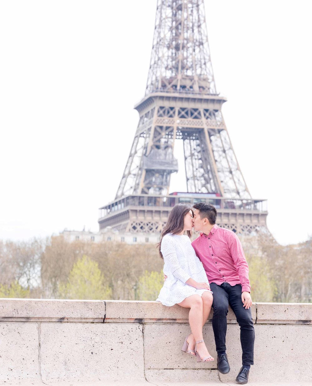 eiffel tower paris surprise proposal couple kissing she said yes