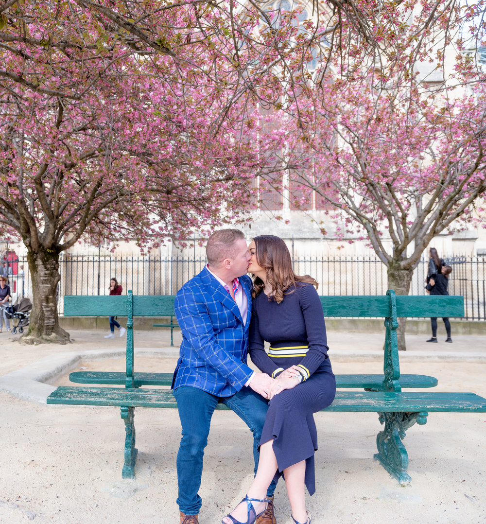 surprise proposal in paris france in gardens at notre dame cathedral