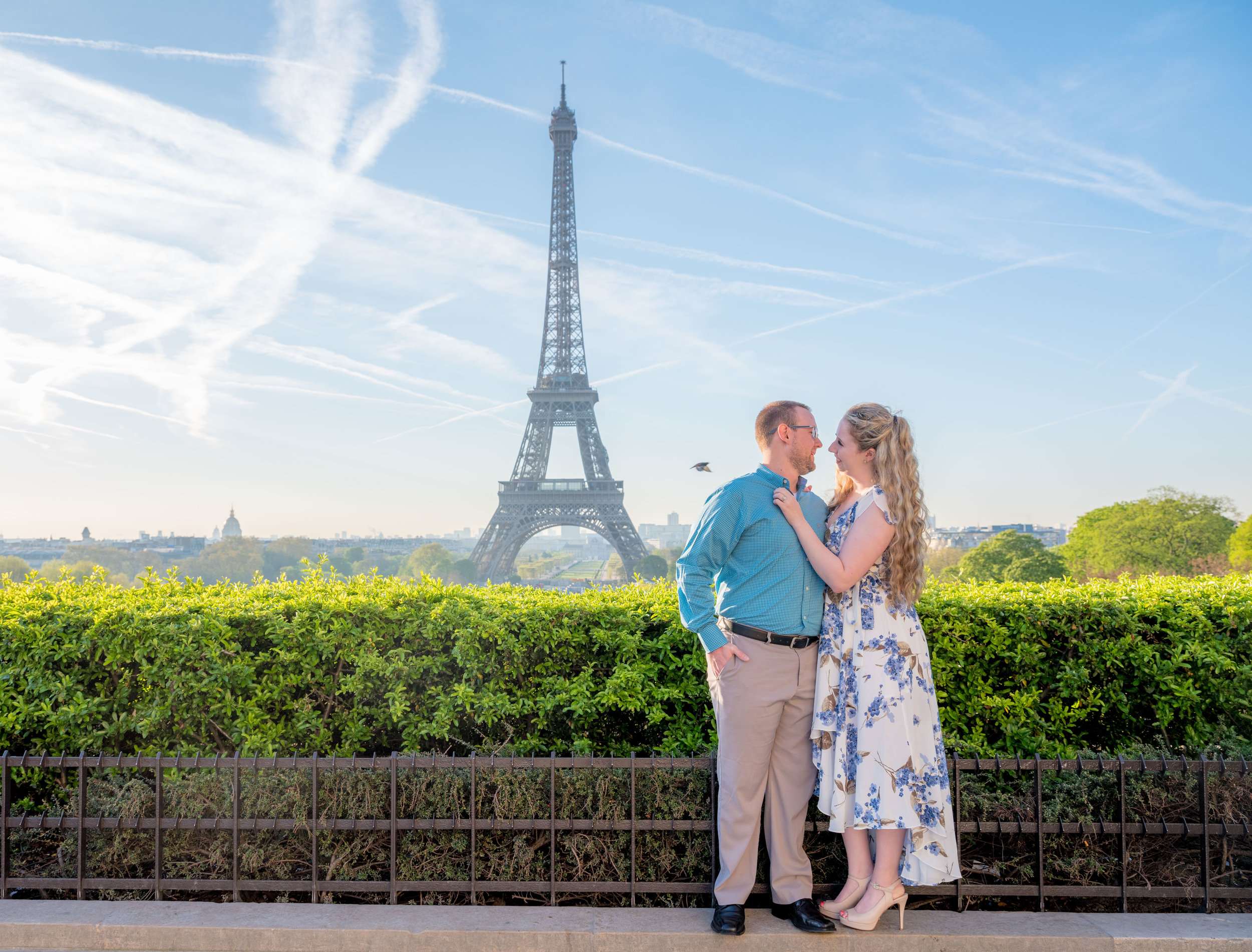 An early summertime weather romantic couples photo session at the Eiffel Tower
