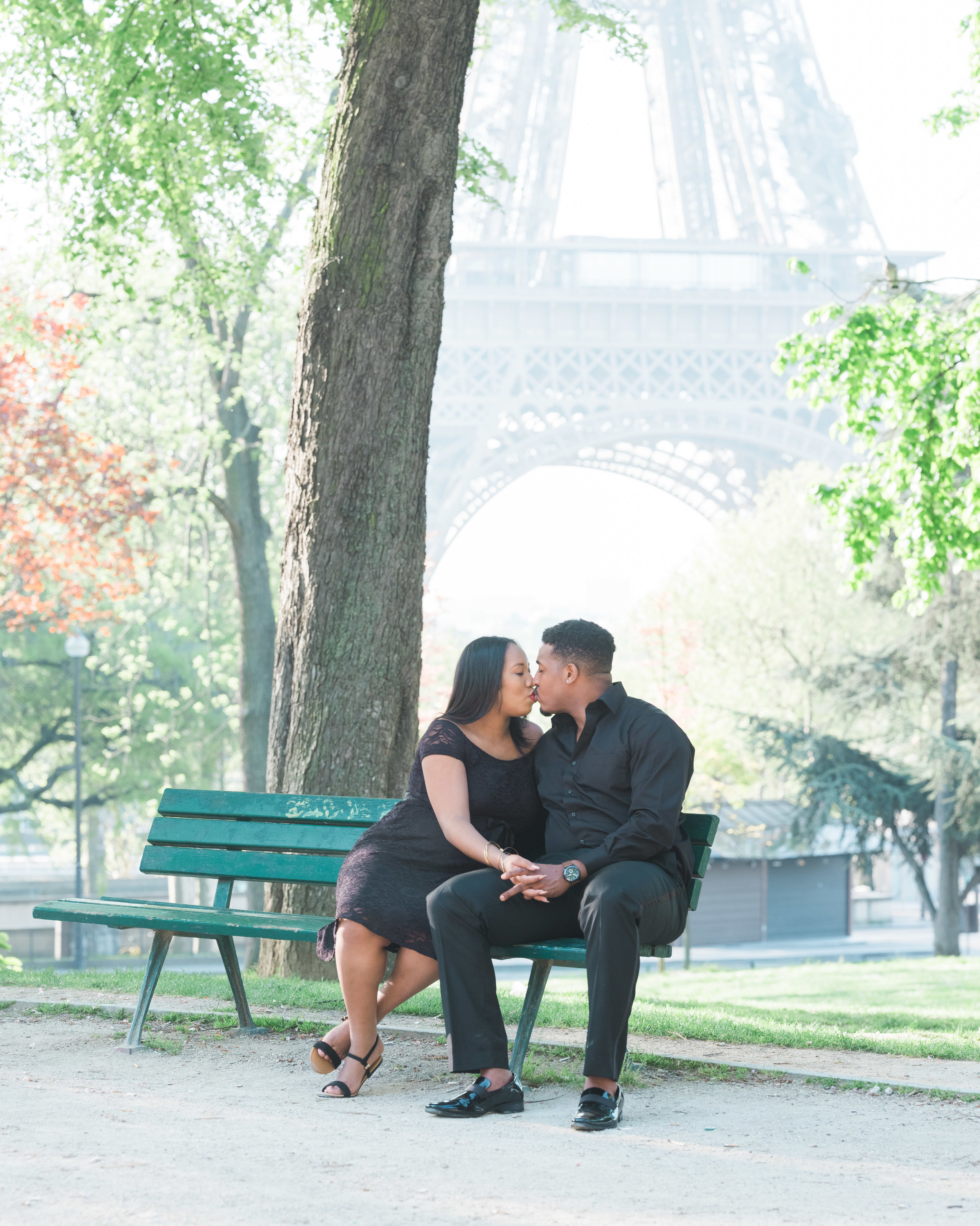 Loving and charming expectant parents photo shoot at the Eiffel Tower