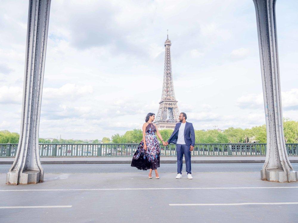elegant and classy couple in love at the bridge of bir hakeim in paris france