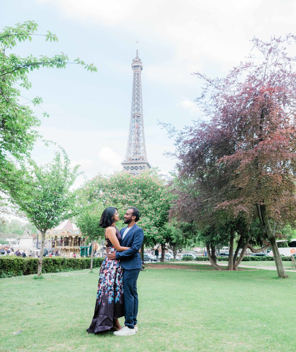 elegant and classy couple in love at the eiffel tower in paris france