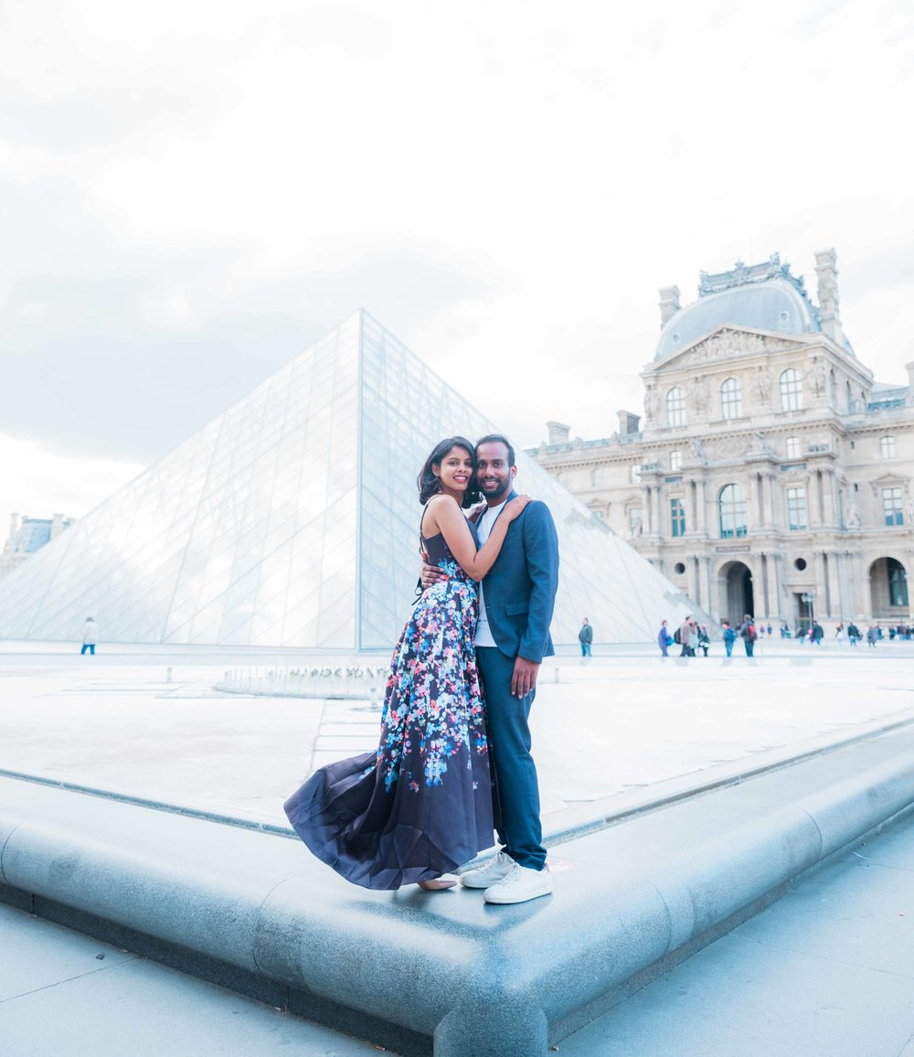 elegant and classy couple in love at the louvre museum in paris france
