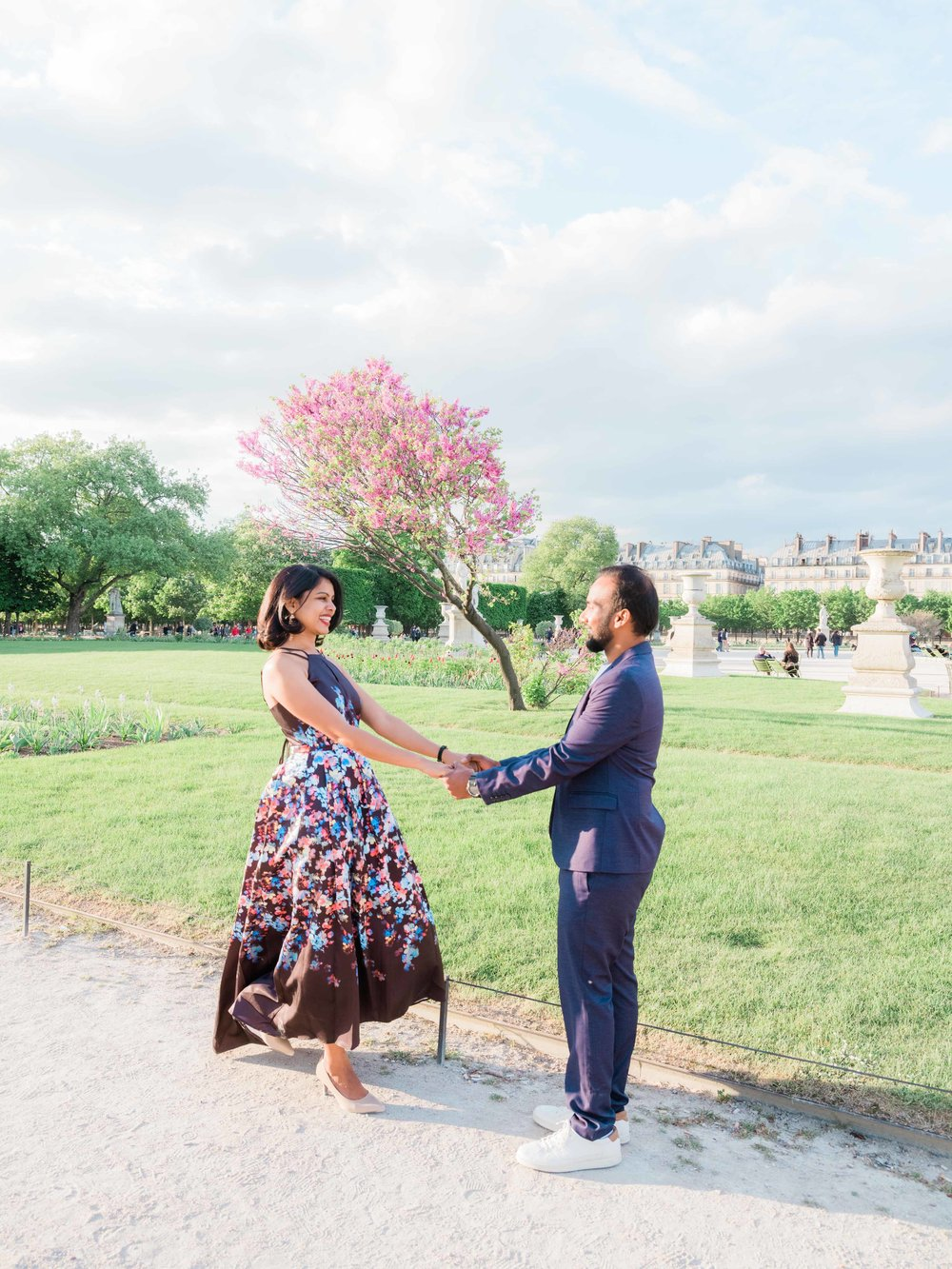 elegant and classy couple in love in the tuileries gardens in paris france