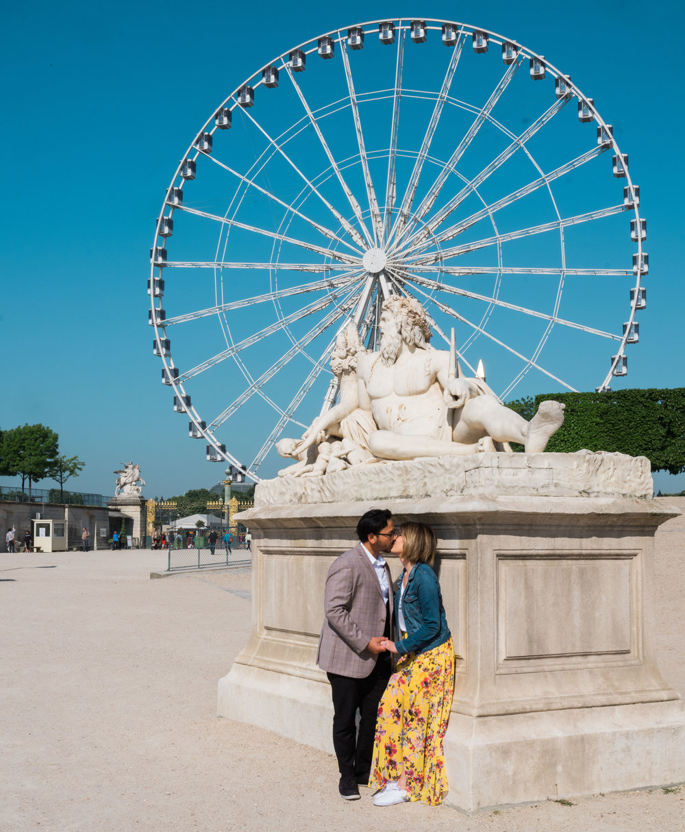 surprise proposal and engagement photo session in the tuileries gardens in paris