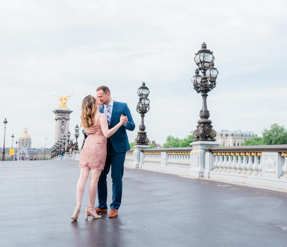 a romantic dance on the pont alexandre in paris france