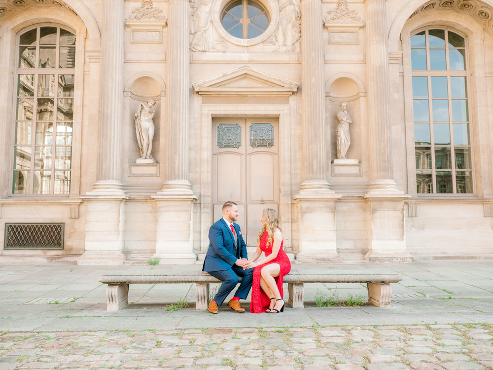 romantic engagement photo shoot in paris france at the louvre museum