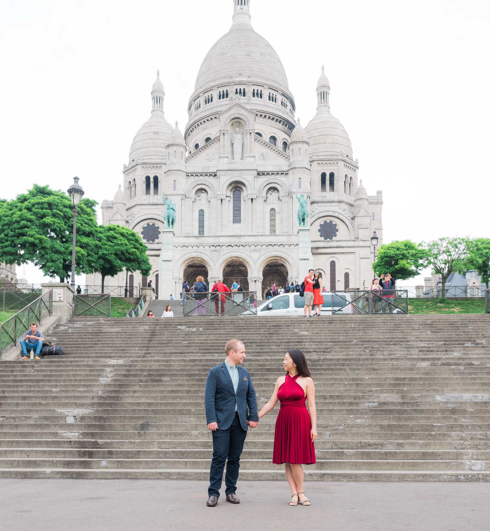 Bright and colorful engagement photo session on the hill of Montmartre in Paris