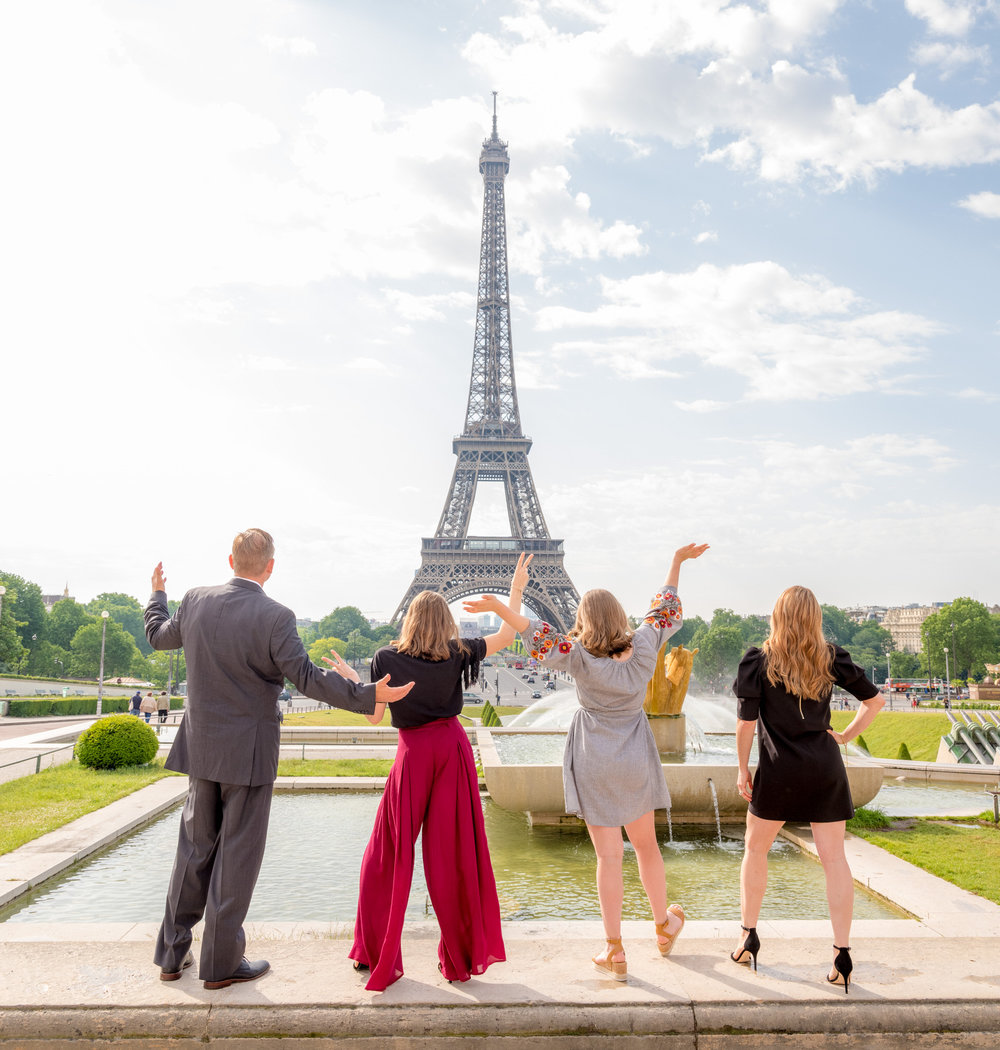 elegant family photo session in paris france at the eiffel tower