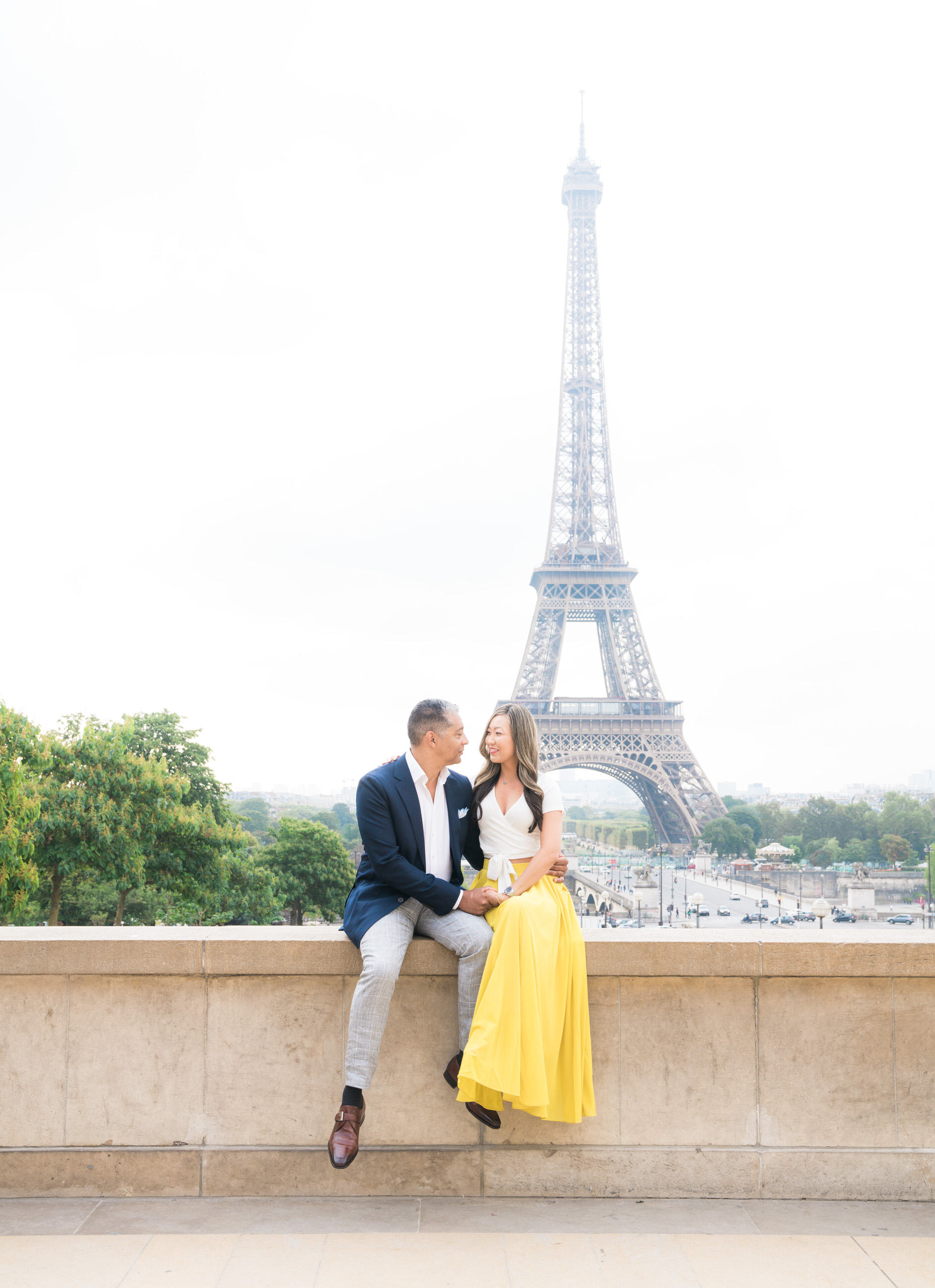 In love, at the Eiffel Tower, what better place to be?