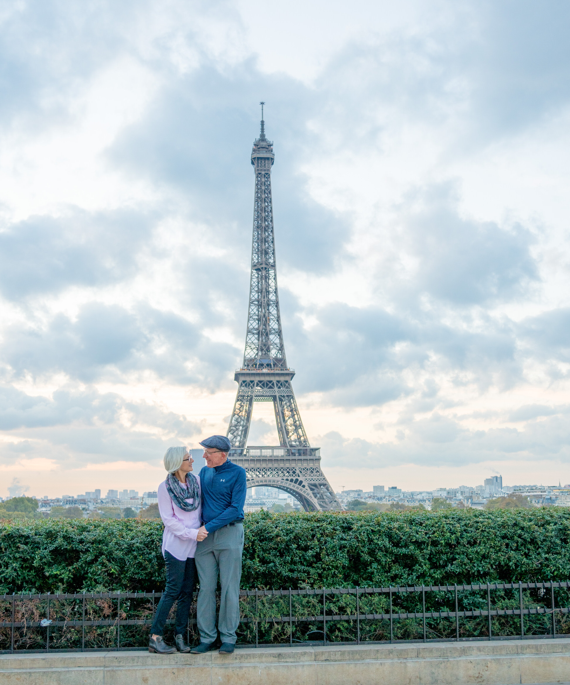 Celebrating a retirement in Paris with a fun couples photo session