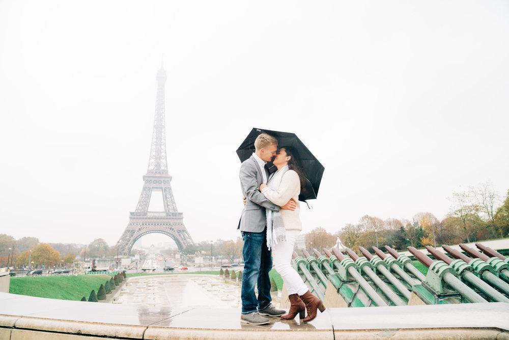 rainy day in paris paris engagement photographer