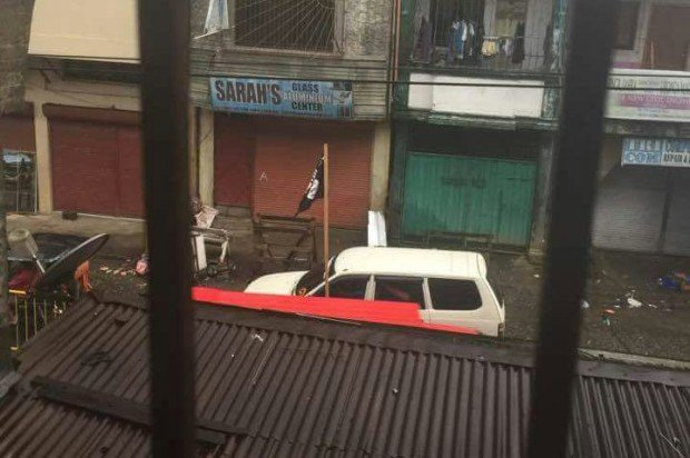 An Islamic State flag is seen at Marawi City where fierce fighting between government security forces and the Abu Sayyaf and Maute groups is raging. CONTRIBUTED PHOTO