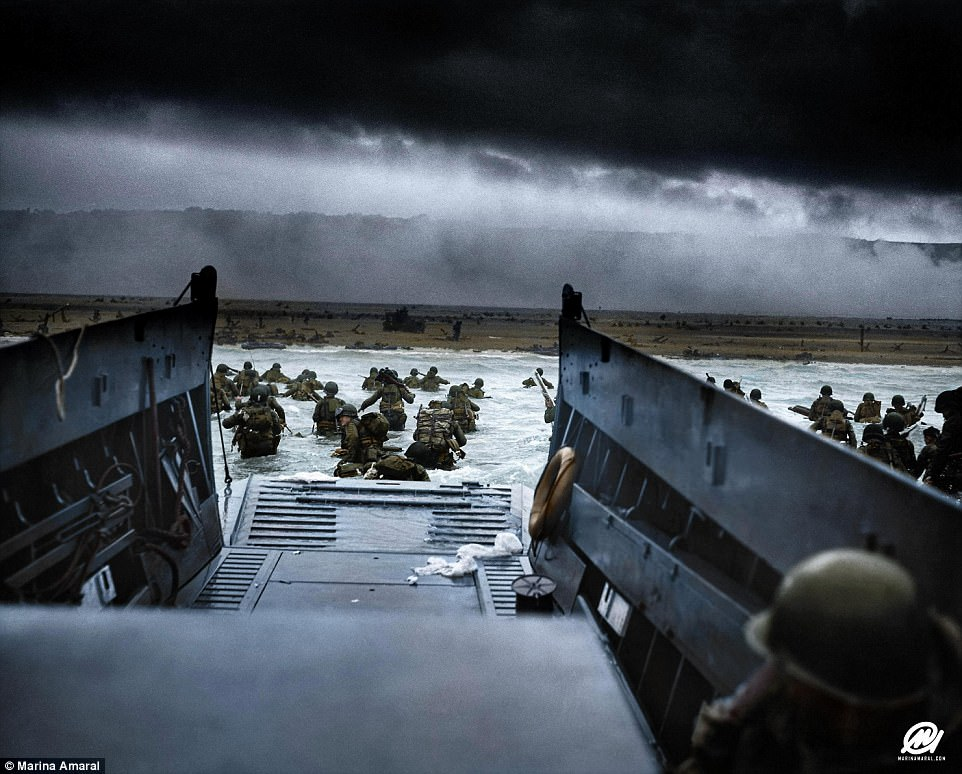 Soldiers from the 16th Infantry Regiment, U.S. 1st Infantry Division wade ashore on Omaha Beach on the morning of June 6 1944. Dramatic images from D-Day have been given a new lease of life after being colourised by a Brazilian artist