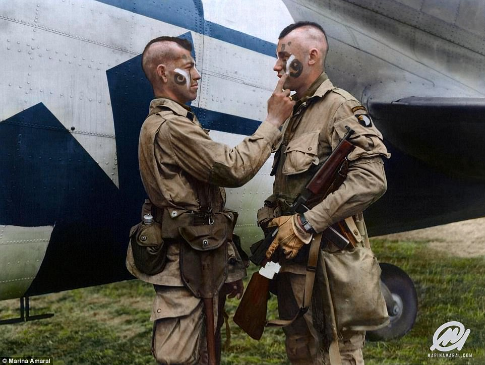 Clarence Ware applies war paint to Charles Plaudo in England on June 5, 1944. They were both members of the so called Filthy Thirteen section of the US 101st Airborne Division. The idea came from unit sergeant Jake McNiece, who was part Chocataw and was designed to energise the men for the danger ahead