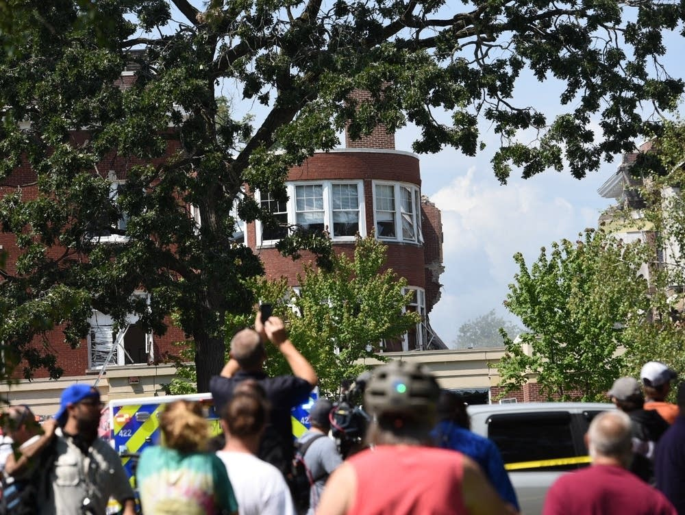 Three people were rescued off the roof of one of the buildings, and another person believed missing was found uninjured.Caroline Yang for MPR News