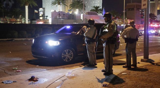 Las Vegas Police stand at the scene of a shooting along the Las Vegas Strip,