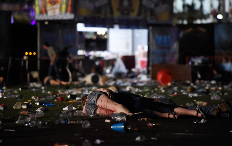 A person lies on the ground covered with blood at the Route 91 Harvest country music festival after apparent gun fire was heard on October 1, 2017 in Las Vegas, Nevada. There are reports of an active shooter around the Mandalay Bay Resort and Casino. (Photo by David Becker/Getty Images)