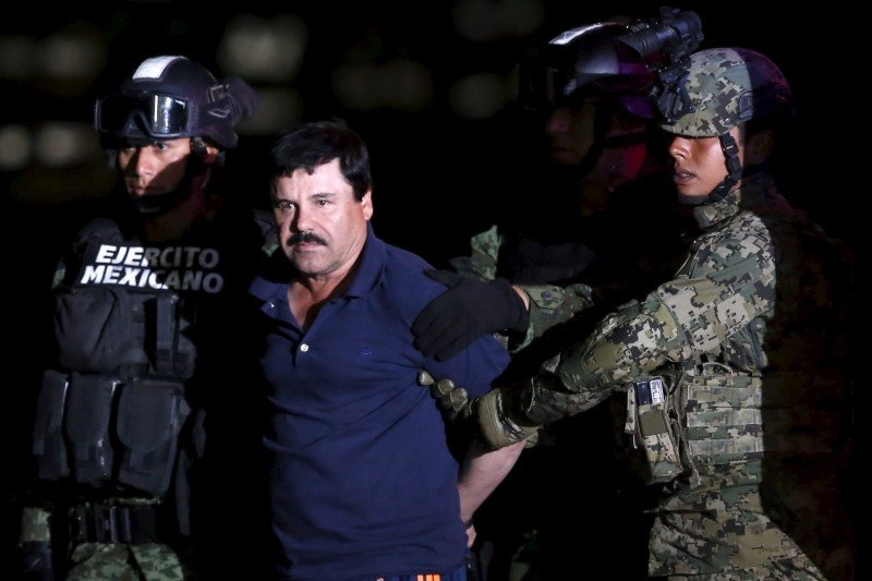 "Joaquín ""El Chapo"" Guzmán is escorted by soldiers during a presentation at a hangar in Mexico City on January 8, 2016. REUTERS/Edgard Garrido"