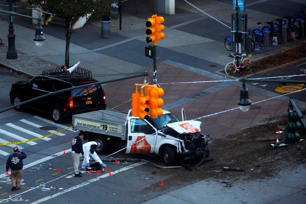 Police investigate a vehicle allegedly used in a ramming incident on the West Side Highway in Manhattan, New York, U.S., October 31, 2017.ANDREW KELLY/REUTERS