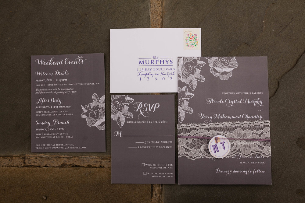Invitation, couple's custom logo and day of paper by Roseville Designs.